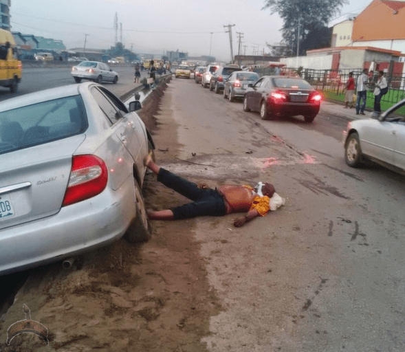 man21 Graphic Photos: Man lying dead next to his car at Ijesha Lagos