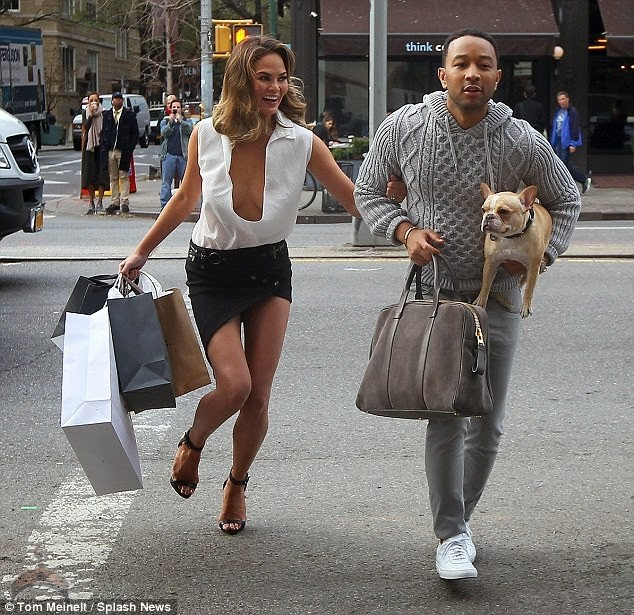 1 52 So John Legend Kisses Wifes Milk Jugs and wife Kiss in Public.