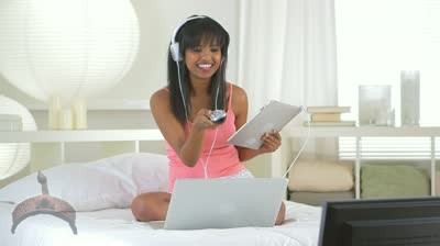 african_lady_watching_video