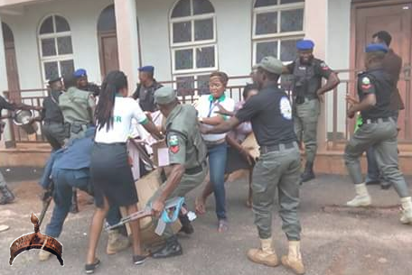 police fighting for bucket