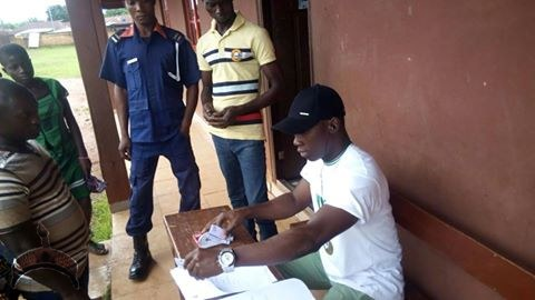 A youth corper distributes pvc ahead of the Edo Governorship election