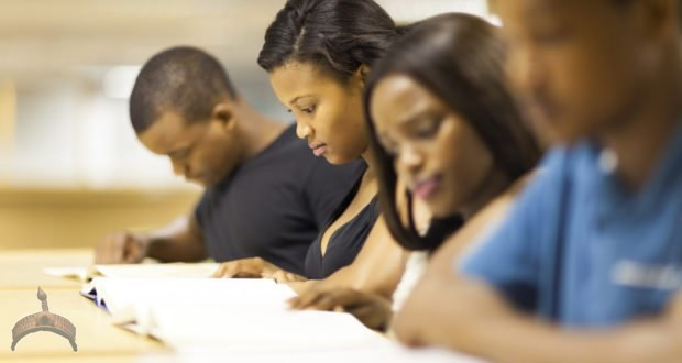 Nigerian college students reading in library