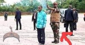 Guinea President umbrella holder removes him from Power